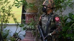 A soldier stands guard as troops arrive at a Hindu temple in Yangon on February 2, 2021, as Myanmar's generals appeared in firm control a day after a surgical coup that saw democracy heroine Aung San Suu Kyi detained
