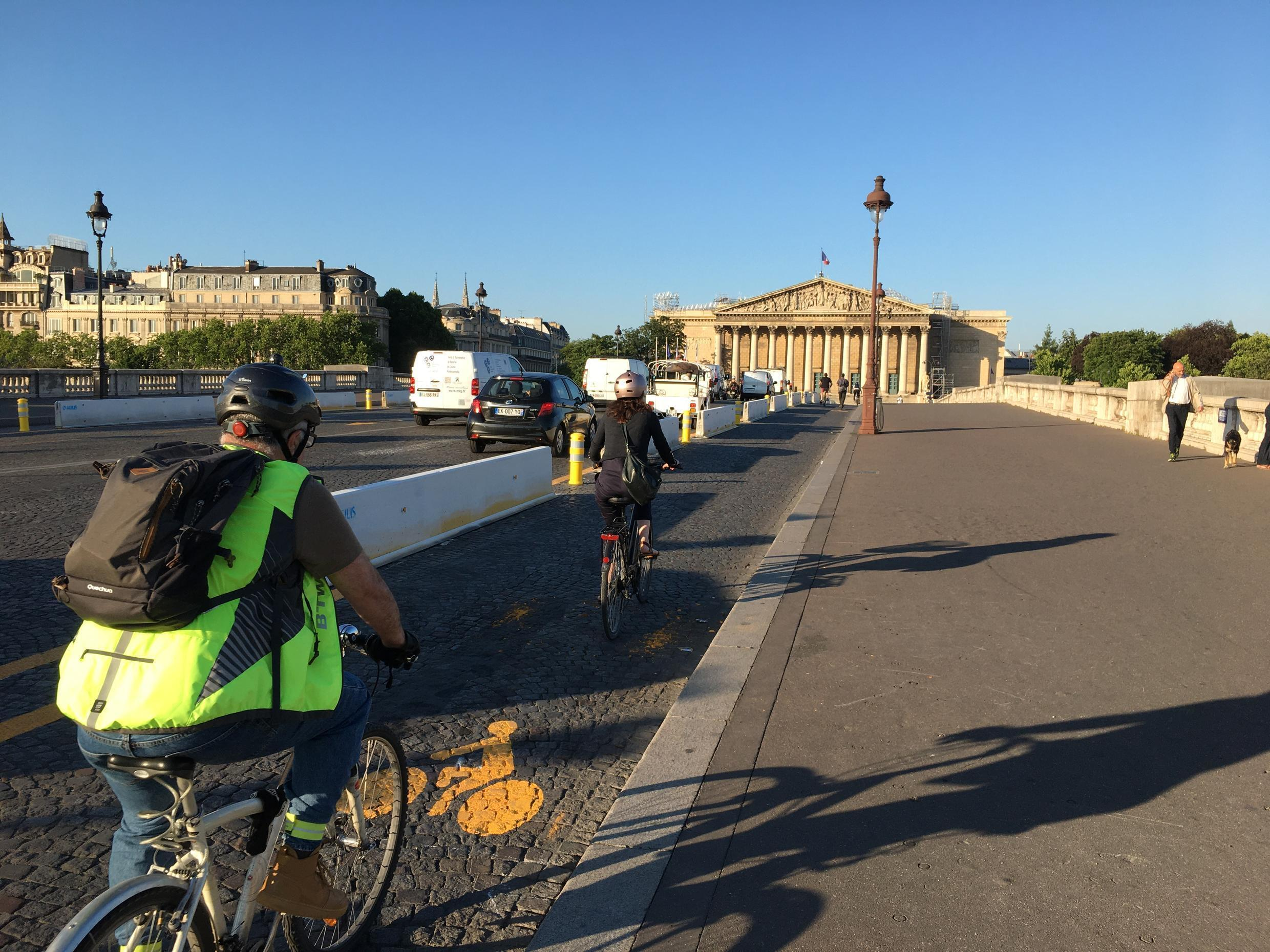 The Pont de la Concorde bridge over Paris's Seine River, leading to the French National Assembly, features one of the temporary bike lanes expected to become permanent in the first part of Mayor Anne Hidalgo's second term.