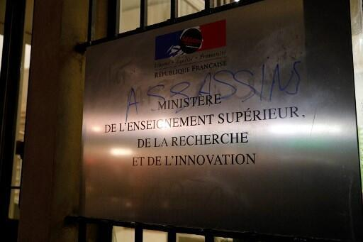 """A picture taken on November 12, 2019 at the Higher Education Ministry in Paris shows a plaque bearing a graffiti reading """"assassins"""" written during a demonstration in support to the student who set himself on fire over financial problems in Lyon."""