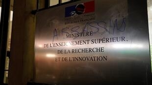 "A picture taken on November 12, 2019 at the Higher Education Ministry in Paris shows a plaque bearing a graffiti reading ""assassins"" written during a demonstration in support to the student who set himself on fire over financial problems in Lyon."