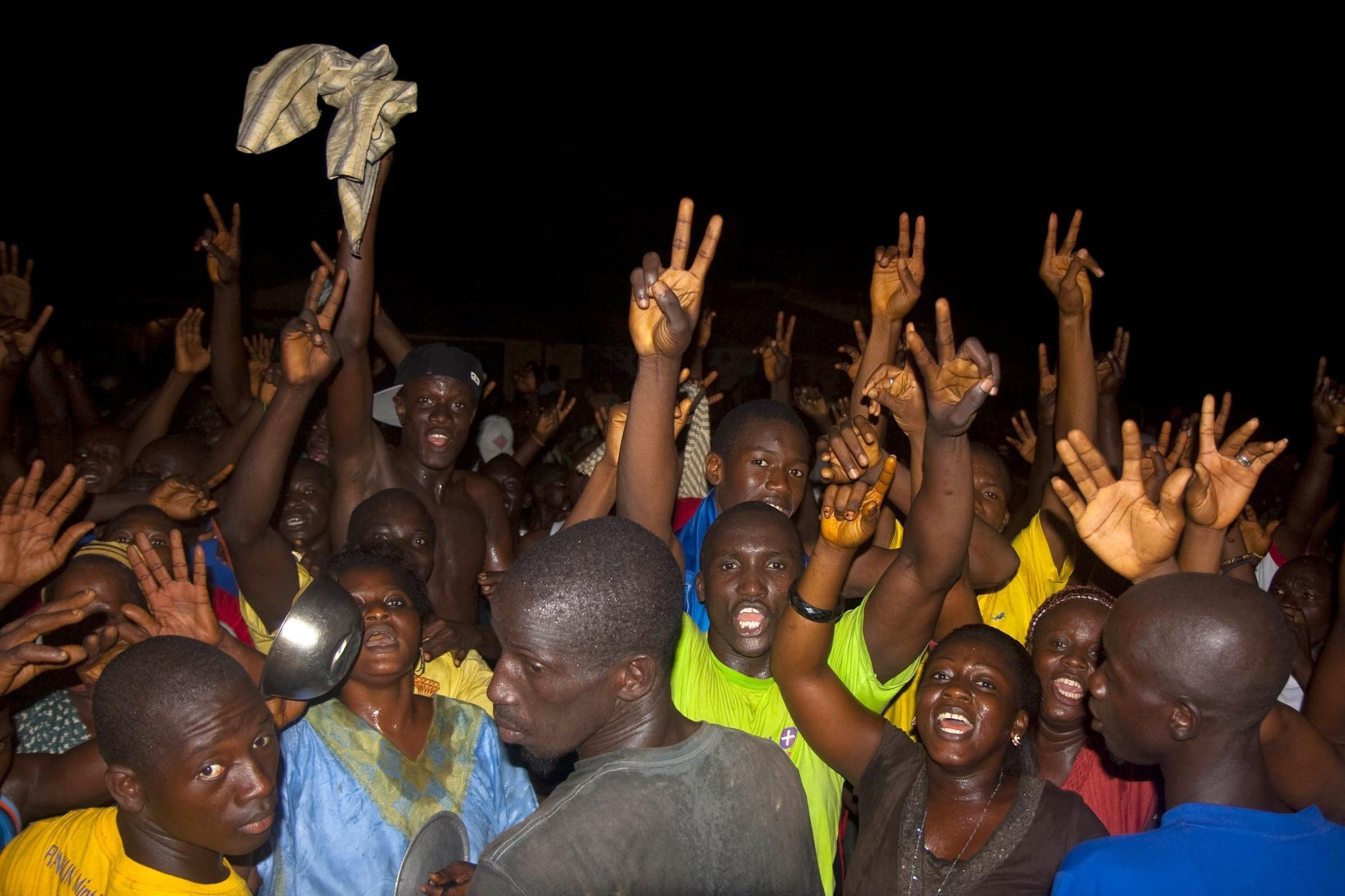 Supporters of Conde celebrate at his Conakry residence on 15 November