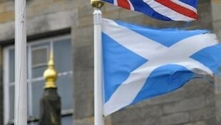 The Union Jack and the Scottish flag blowing in the wind in Edinburgh