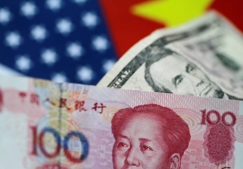 Đô la Mỹ và nhân dân tệ của Trung Quốc. Ảnh minh họa.