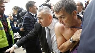 A shirtless Xavier Broseta (R), Executive Vice President for Human Resources at Air France, is evacuated by security after a staff meeting turns violent. Roissy, near Paris, France, October 5, 2015