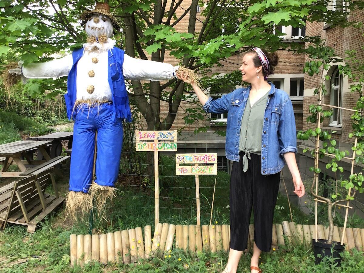At the Cité Universitaire's American residence, some students have cleared overgrown land to create a neat garden. Art student Hope Curran poses with the garden's scarecrow, named Covid-19