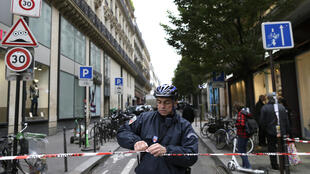 A policeman near entrance of French daily newspaper Libération