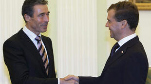 Dmitry Medvedev (L) shakes hands with Nato secretary-general  Anders Fogh Rasmussen