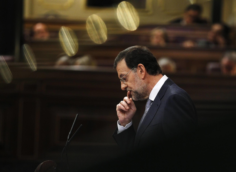 Премьер-министр Испании Мариано Рахой выступает перед испанским парламентом 11 июля 2012 г.