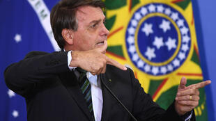 Brazilian President Jair Bolsonaro, pictured in Brasilia on February 9, 2021, looks increasingly inclined to ditch tight-belt, small-government policies for populist economics