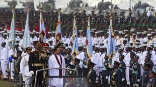 Sri Lanka's President Mahinda Rajapaksa inspects a parade during the war victory celebrations in Colombo