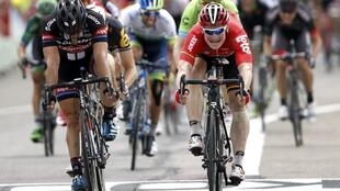 Andre Greipel (right) sprints ahead of John Degenkolb of Germany (left) to win the 15th stage of this year's Tour de France on Sunday.