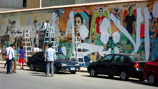 Whitewashing their own work, but with a difference. Mohamed Mahmoud St, Cairo, 24 May 2012