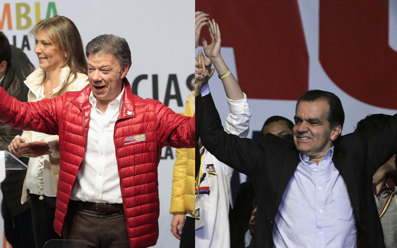 Juan Manuel Santos, presidente colombiano e candidato à reeleição (esq), e Oscar Ivan Zuluaga, candidato da oposição (dir), durante campanha em Bogotá em dia 25 de maio de 2014.