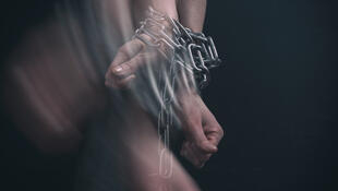 women-hands-chained-break-out-motion_108611-536