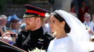Meghan Markle et le prince Harry quittent la chapelle St-George au château de Windsor après leur mariage le samedi 19 mai 2018.