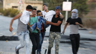 Palestinian demonstrators injured after confronting police