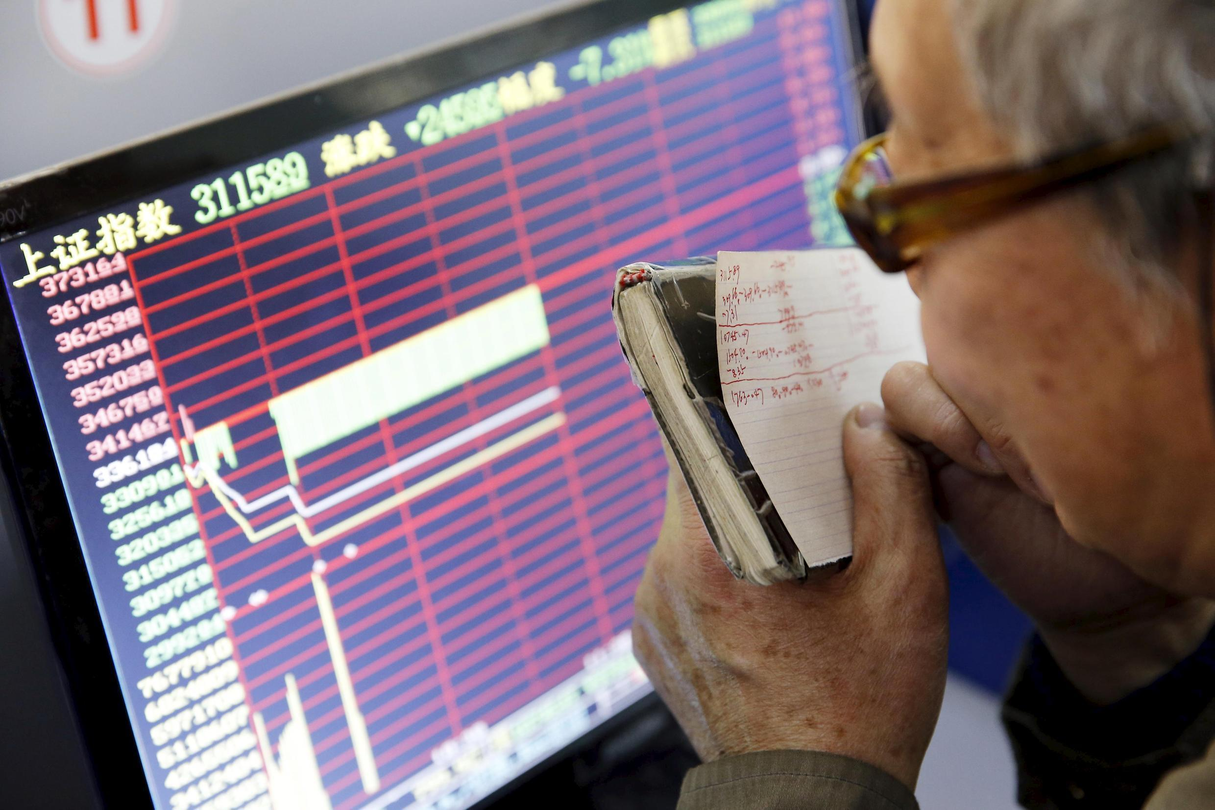 """An investor in Shanghai watches the market after China's """"circuit breaker"""" mechanism is activated"""
