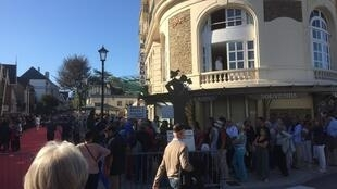 Fans of British cinema and the Dinard Film Festival queue for a seat at the Alizés Cinema halls
