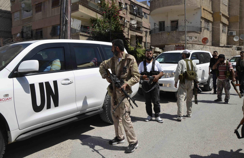 Эксперты ООН по химоружию под Дамаском 28 августа 2013.