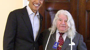 US President Barack Obama with French-born tailor Georges De Paris at the White House in Washington, 2014.