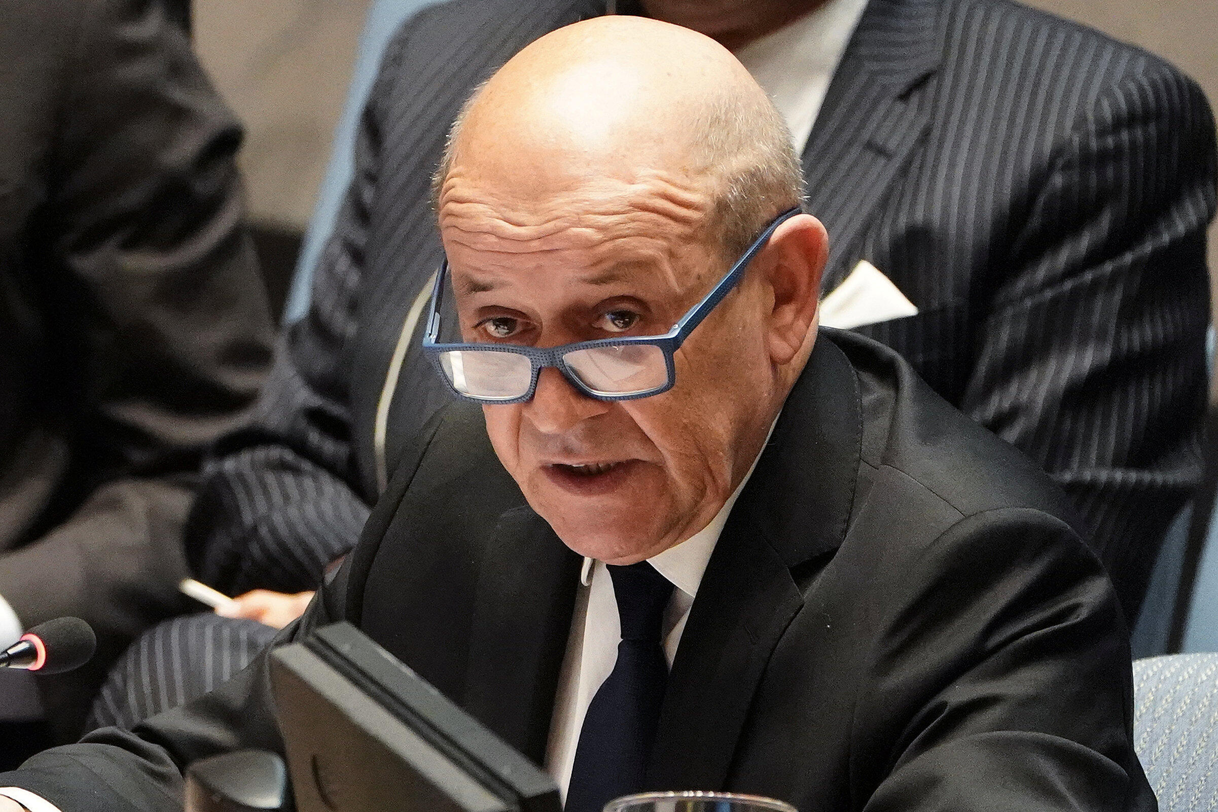 French Foreign Minister Jean-Yves Le Drian speaks with an aide at the United Nations during a meeting about combatting the financing of terrorism in New York, New York, U.S., March 28, 2019.