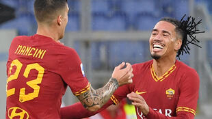 English defender Chris Smalling (R) joined Roma from Manchester United