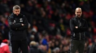 Manchester United manager Ole Gunnar Solskjaer (left) says he has been impressed with his squad's strength of character as they chase a rampant Manchester City side led by Pep Guardiola (right) in the Premier League.