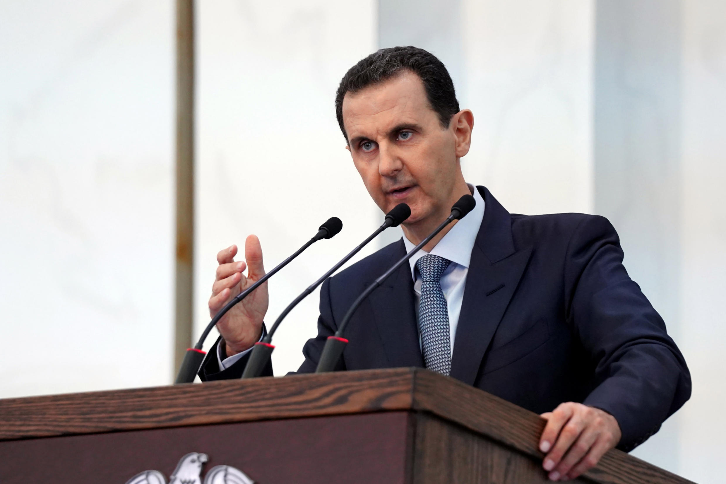 """In response to new US sanctions, Syrian President Bashar al-Assad (shown in a handout picture released by the official Syrian Arab News Agency) said, """"The escalation to strangle the Syrian people continues"""""""