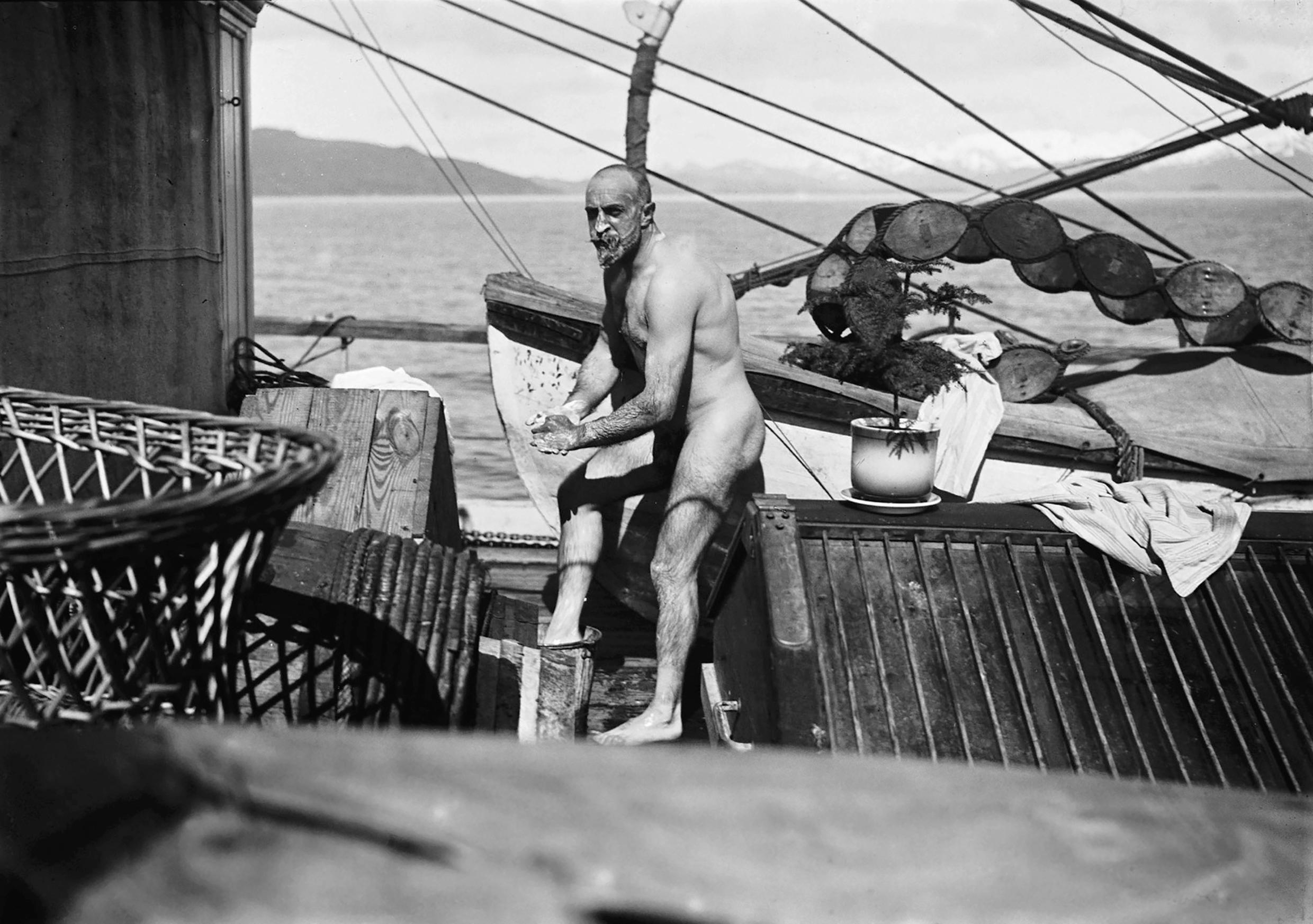 French explorer Jean Baptiste Charcot, taking a bath on board the ship Pourquoi Pas in February 1909.
