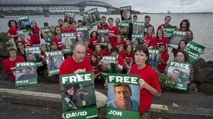 Greenpeace members protest at the detention of the 30 activists and journalists