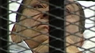 Former Egyptian President Hosni Mubarak is seen in the courtroom for his trial at the Police Academy in Cairo