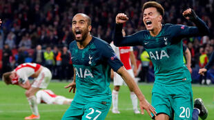 Tottenham's Lucas Moura celebrates scoring their third goal to complete his hat-trick with Dele Alli