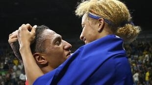 Tony Yoka  of France celebrates with fellow gold medallist Estelle Mossely of France after winning his bout in Rio on 21 August 2016.