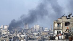 Scènes de bombardements à Homs, en Syrie, le 11 mars 2013