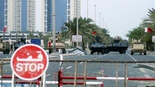 Armoured vehicles belonging to Gulf Cooperation Council military forces guard the entrance to Pearl Square in Manama.