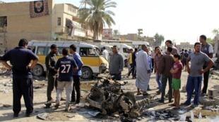Cảnh sau vụ khủng bố tại một trạm xe buýt ở Al Mashtal, Bagdad, Irak, ngày 27/10/2013