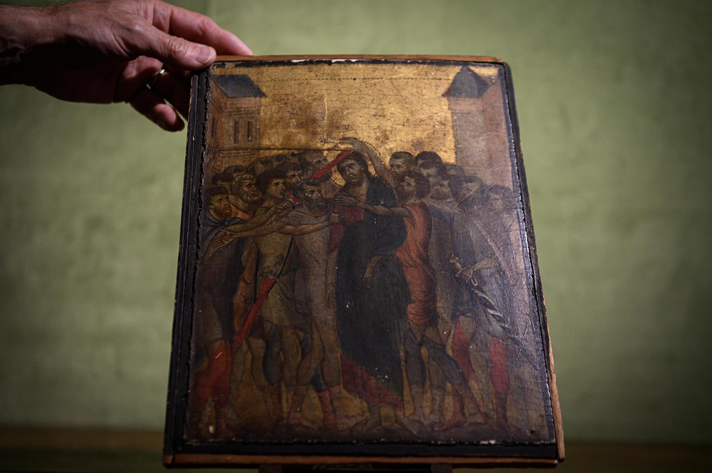 """This photo taken on September 23, 2019 in Paris shows a painting entitled """"the Mocking of Christ"""" by the late 13th century Florentine artist Cenni di Pepo also known as Cimabue. The painting will be auctioned in Senlis on October 27, 2019."""