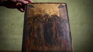 "This photo taken on September 23, 2019 in Paris shows a painting entitled ""the Mocking of Christ"" by the late 13th century Florentine artist Cenni di Pepo also known as Cimabue. The painting will be auctioned in Senlis on October 27, 2019."