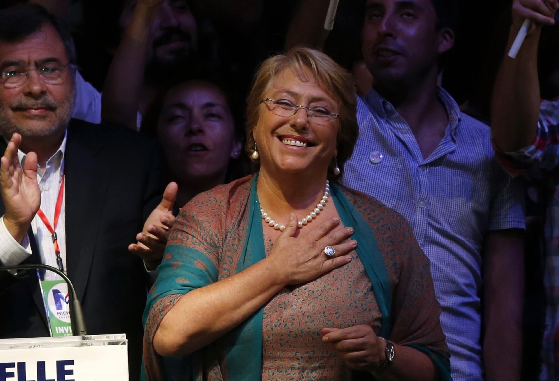 Мишель Бачелет празднует победу в Сантьяго де Чили 15/12/2013