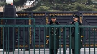 Paramilitary policemen stand guard outside the North Korean embassy in Beijing November 30, 2010.