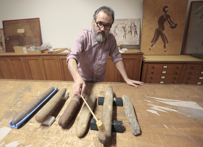 Paleomusicologist and lithophone specialist Erik Gonthier plays a prehistoric lithophone