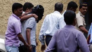 Detenção do segundo suspeito de estupro coletivo na Índia, neste sábado 24 de agosto de 2013.
