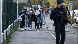 Students return to the the Bois d'Aulne middle school in Conflans-Sainte-Honorine after Paty's murder in October 2020.