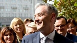 Poland's most prominent gay politician, Robert Biedron, smiles as he speaks to the media during a press conference in Warsaw on September 4, 2018.