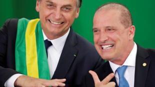 Brazil's new President Jair Bolsonaro next to Onyx Lorenzoni, his new chief of staff, during a ceremony in Brasilia, Brazil January 1, 2019.