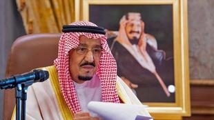Saudi King Salman bin Abdulaziz speaking during a televised speech, addressing the nation about the COVID-19 coronavirus disease pandemic.