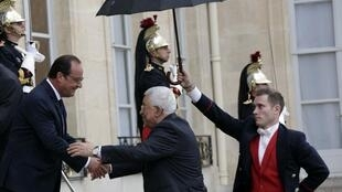 French President Francois Hollande (L) welcomes Palestinian President Mahmoud Abbas to the Elysee Palace on Tuesday