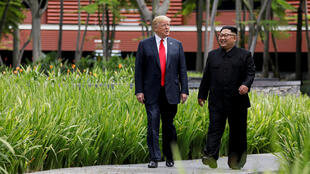 A file picture of US President Trump and North Korean leader Kim Jong Un during their summit in June.