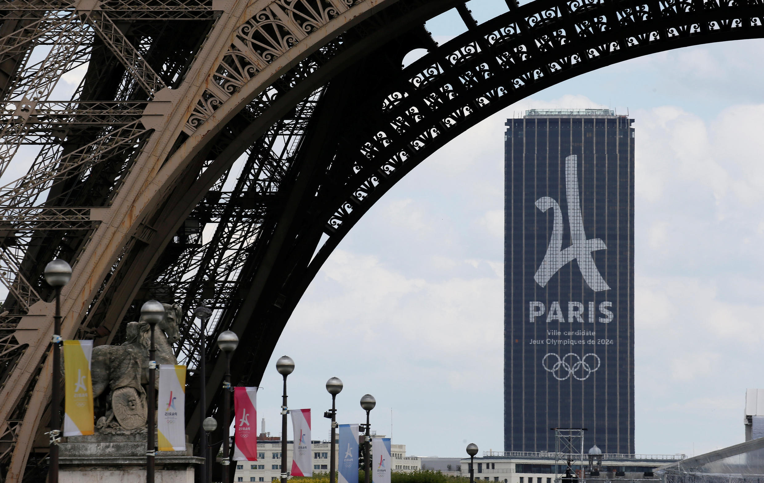 The logo of the Paris candidacy for the 2024 Olympics is seen on the Montparnasse tower in this file picture.