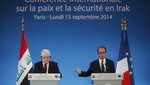 Hội nghị Paris về hòa bình và an ninh tại Irak. Tổng thống Pháp  François Hollande (P) phát biểu cùng Tổng thống Irak, Fouad Massoum, người Kurdistan. Ông Massoum là Tổng thống thứ hai của Irak không phải là người Ả Rập, 15/09/2014.